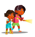 two frightened indian girls shine with flashlight vector image