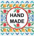 handmade round frame over a colored cross stitch vector image
