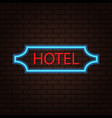 neon sign of a hotel on a brick wall vector image vector image