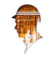 paper cut builder head in hard hat silhouette