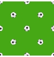 Soccer balls over green field seamless pattern vector image