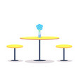 empty round table with flowers on top two chairs vector image
