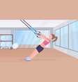 sporty woman doing exercises with suspension vector image vector image