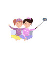 two girls in pajamas making selfie photo cartoon vector image