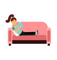 young woman sitting on a pink sofa and reading a vector image vector image