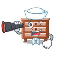 sailor with binocular character bedside table in vector image