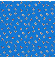 Seamless retro pattern of small flowers on blue vector image vector image