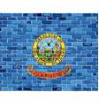flag of idaho on a brick wall vector image vector image