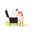young man grilling sausages on barbecue grill vector image