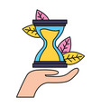 hand holding hourglasses vector image vector image