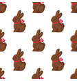 seamless pattern chocolate bunny with pink ribbon vector image vector image