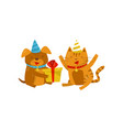 funny dog and cat in party hats sitting on the vector image