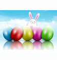 easter bunny and eggs on a blue sky background vector image vector image