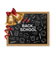 golden bell and chalk board realistic back vector image vector image