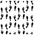 Black and white human feet prints seamless pattern