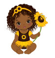 cute african american baby girl holding sunflower