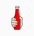 hand hold ketchup bottle male holding a tomato vector image