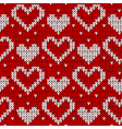 red knitted background with hearts vector image
