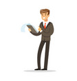 smiling businessman standing and holding notepad vector image vector image