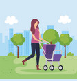 mother with cart baby in the park vector image