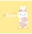 cute rabbit holding colorful easter egg vector image