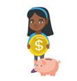 african girl putting a coin into a piggy bank vector image