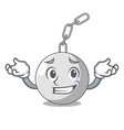 grinning wrecking ball hanging from chain cartoon vector image