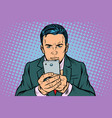 man looks at the smartphone vector image vector image