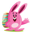 pink easter bunny with big ears carry an egg and vector image