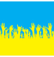 hand with Ukraine flag vector image vector image