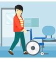 Man pushing wheelchair vector image vector image