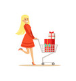 happy woman in a red dress walking with a shopping vector image vector image