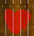 Painted red heart over wooden fence vector image
