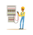 electrician engineer measuring the voltage output vector image vector image