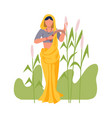 asian female farmer with hook reaping plant