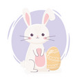 happy easter cute rabbit with yellow egg vector image