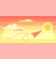 paper plane flying over sunset sky landscape vector image vector image