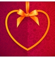 Orange heart shape frame hanging on silky ribbon vector image