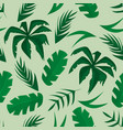 seamless pattern with tropical leaves on green vector image vector image