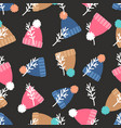 warm winter hats with pompon seamless pattern vector image