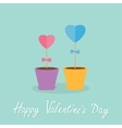 Two heart stick flowers in the pots and word love vector image