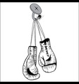 Boxing gloves hang with laces nailed to wall vector image vector image