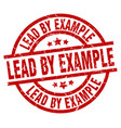 lead by example round red grunge stamp vector image vector image