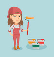 young caucasian painter holding a paint roller vector image vector image