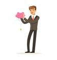 businessman shaking an empty piggy bank vector image