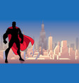 superhero standing tall in city silhouette vector image vector image