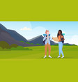 women hikers couple with backpack holding travel vector image vector image