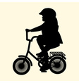 a silhouette of a little girl on a small bicycle vector image vector image