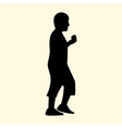 a silhouette of a little boy is walking and eating vector image vector image