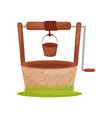 old stone water well wooden bucket hangs on rope vector image vector image